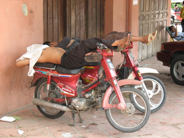 asleep on bikes - phnom penh.jpg